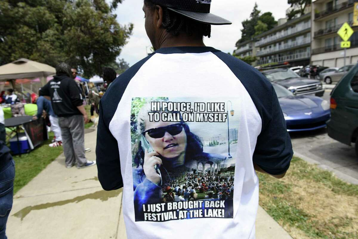Brian Thomas wears a shirt at BBQ'n While Black with a picture of the woman who called police in the initial incident.