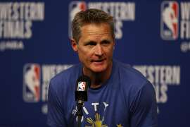 HOUSTON, TX - MAY 16:  Head coach Steve Kerr of the Golden State Warriors speaks to the media prior to playing against the Houston Rockets in Game Two of the Western Conference Finals of the 2018 NBA Playoffs at Toyota Center on May 16, 2018 in Houston, Texas.  (Photo by Ronald Martinez/Getty Images)