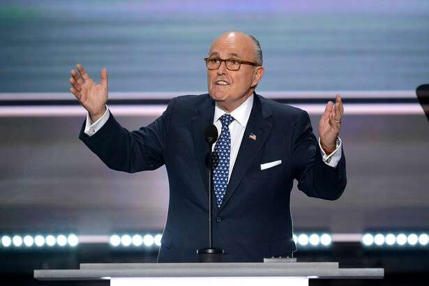 (FILES) In this file photo taken on July 18, 2016, former New York City Mayor Rudy Giuliani addresses delegates on the first day of the Republican National Convention in Cleveland, Ohio. Giuliani, lawyer to US President Donald Trump, says the investigation into Russian interference in the 2016 election and possible collusion with Trump's campaign will end by September 1. Giuliani told The New York Times on May 20, 2018, that the office of Robert Mueller, the special counsel who is leading the investigation, had shared the timeline some two weeks ago.  / AFP PHOTO / Robyn BECKROBYN BECK/AFP/Getty Images