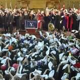 """New Haven, Connecticut - Sunday,  May 20, 2018:  Yale University's Class Day concludes at Woolsey Hall in New Haven as the Yale College class of 2018, faculty and guests wave the Yale Handkerchief during the singing of the last line of """"Bright College Years,""""  a custom inaugurated by the Class of 1984"""