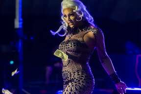 """Tatianna, a season two contestant on """"RuPaul's Drag Race"""", performs during the first Miss Revelation Drag Pageant and Live Show on Saturday night at the Tri-City Sports Complex in Auburn. (Katy Kildee/kkildee@mdn.net)"""