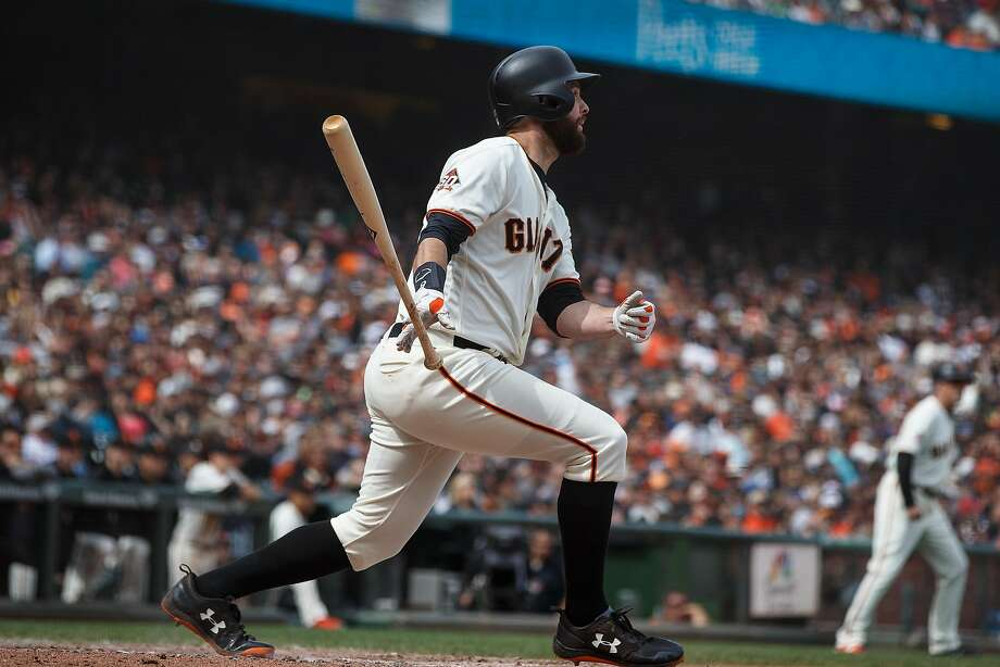 Brandon Belt #9 of the San Francisco Giants hits a three run home run against the Colorado Rockies during the seventh inning at AT&T Park on May 20, 2018 in San Francisco, California. The San Francisco Giants defeated the Colorado Rockies 9-5.  Photo: Jason O. Watson / Getty Images