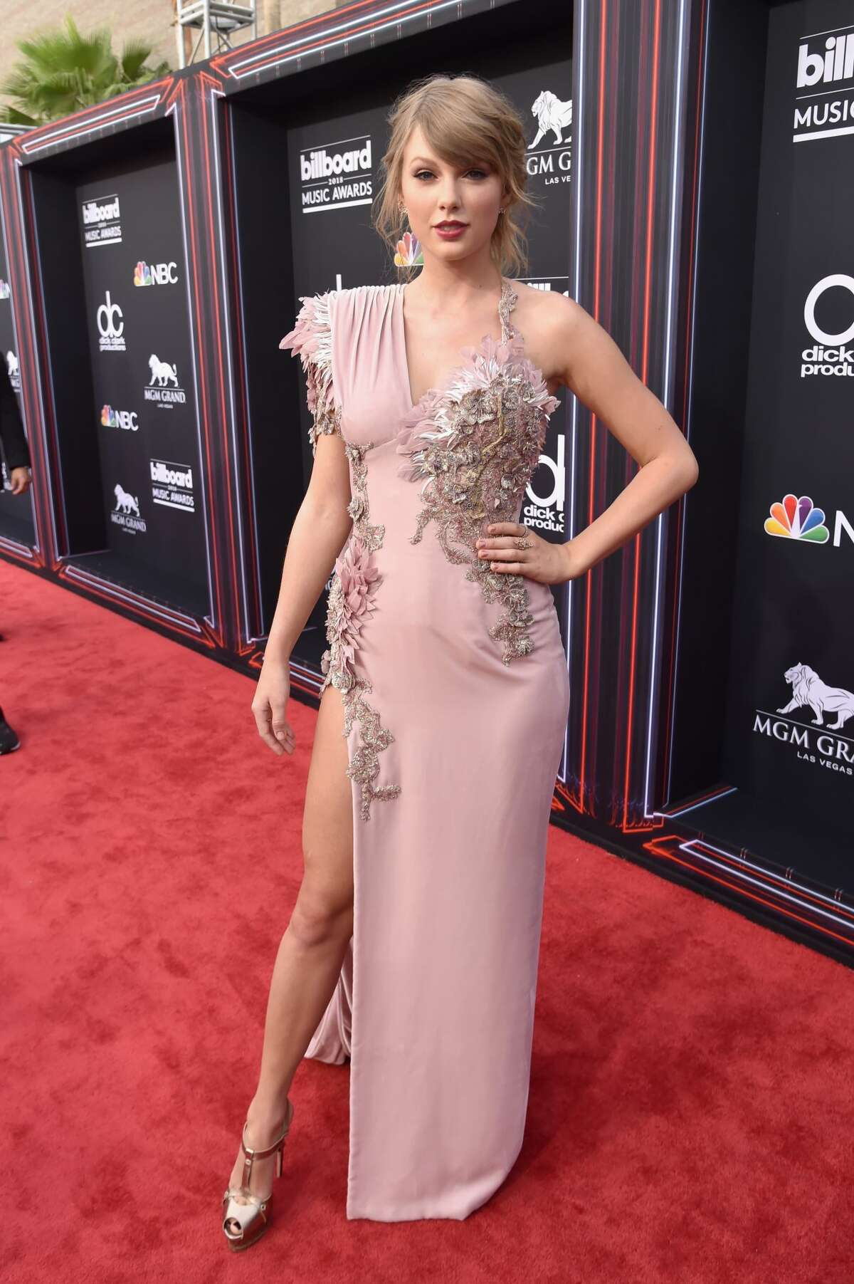 Worst:These awkwardly placed embellishments on Taylor Swift's dress are far from flattering.