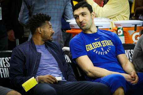 Leandro Barbosa and Golden State Warriros player Zaza Pachulia chat ahead of Game 3 of the Western Conference Finals between the Golden State Warriors and the Houston Rockets in Oakland, California, on Sunday, May 20, 2018.