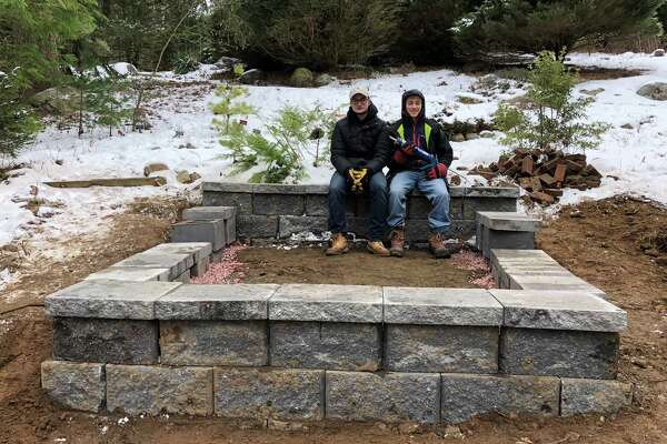 Sam Terr, left, and Josh Appel, of Stamford, working on Terr s Eagle Scout project in the Bartlett Arboretum.