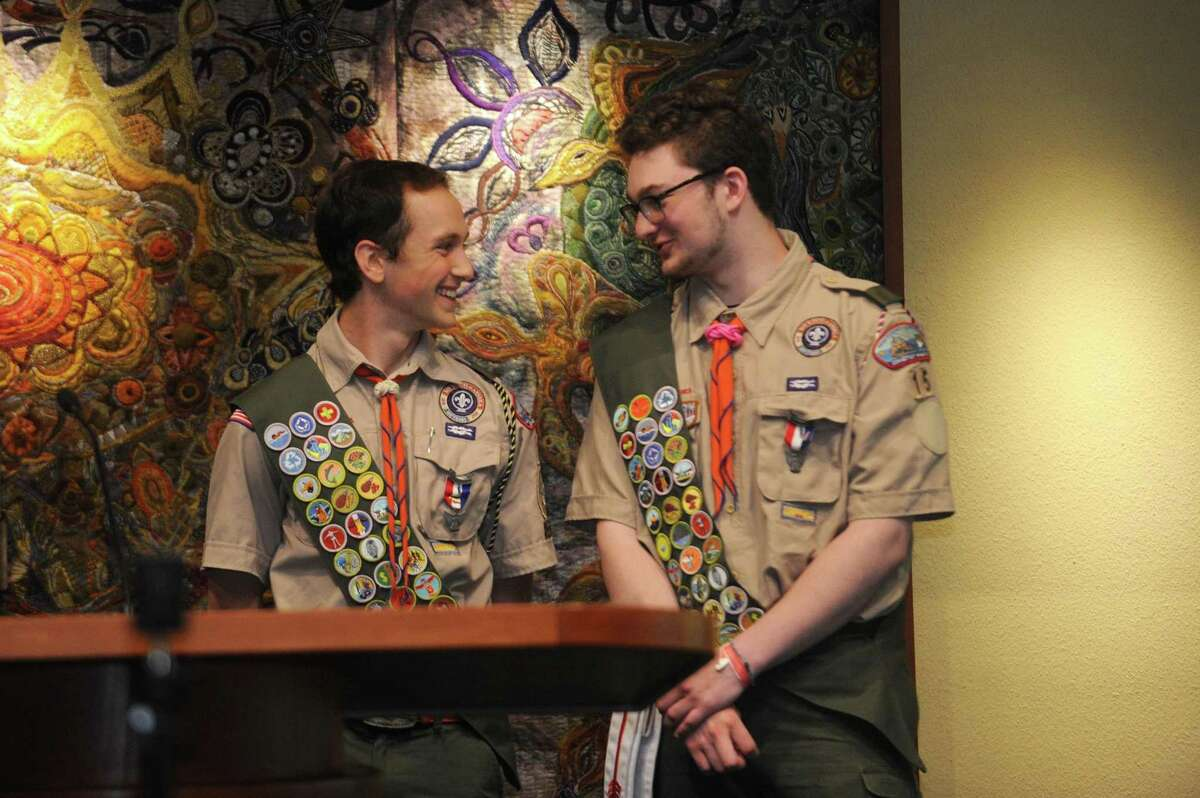 New Eagle Scouts Josh Appel, left, and Sam Terr share a smile during a standing ovation following the Stamford Boy Scout Troop 15's Eagle Court of Honor, inside Temple Sinai on Lakeside Dr. in Stamford, Conn. on Sunday, May 20, 2018.