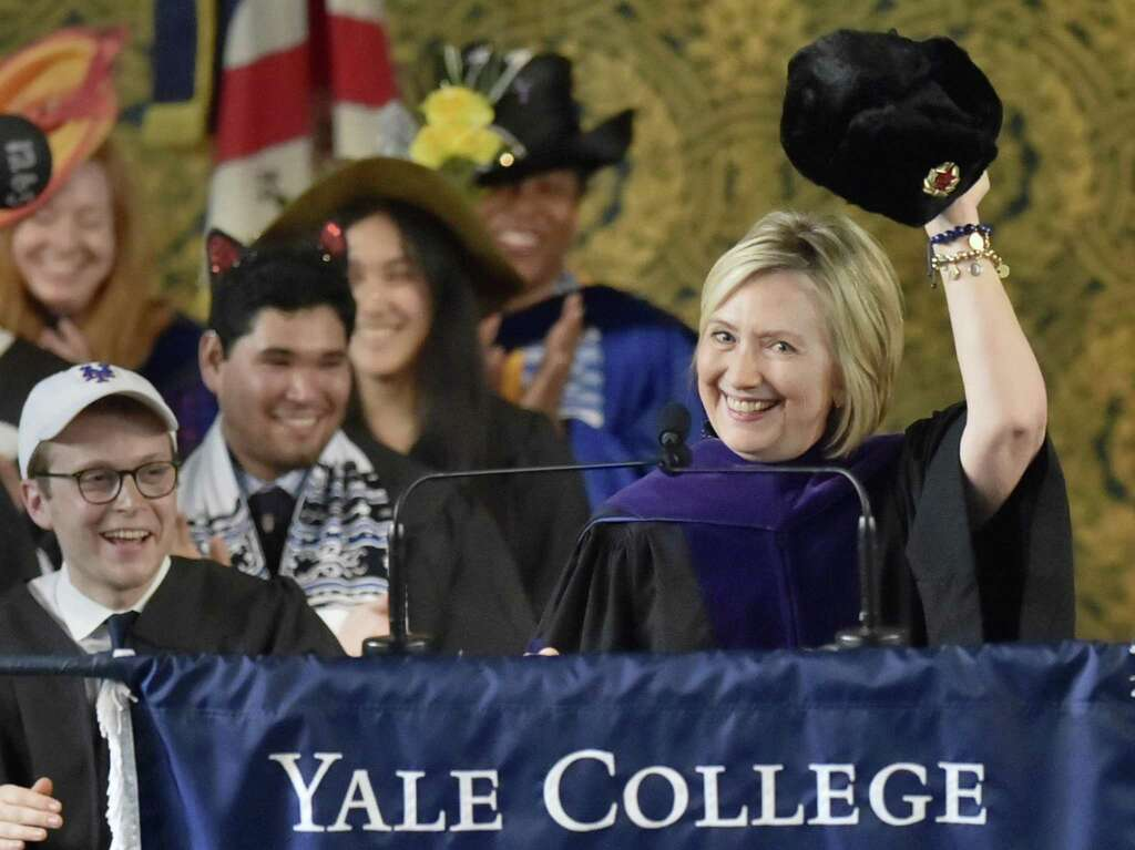 New Haven, Connecticut - Sunday,  May 20, 2018: Former Secretary of State and former Democratic Presidential candidate Hillary Clinton holds up a Russian fur hat, an ushanka, with a Soviet era hammer and cycle emblem during her Class Day address Sunday afternoon at Yale University's Woolsey Hall in New Haven to the Yale College class of 2018.  As a tradition, Yale students and faculty wear humorous and playful hats during Class Day Exercises. Photo: Peter Hvizdak / Hearst Connecticut Media / New Haven Register