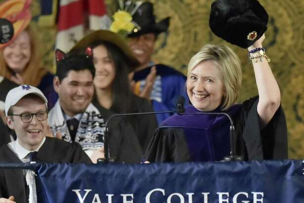 New Haven, Connecticut - Sunday, May 20, 2018: Former Secretary of State and former Democratic Presidential candidate Hillary Clinton holds up a Russian fur hat, an ushanka, with a Soviet era hammer and cycle emblem during her Class Day address Sunday afternoon at Yale University's Woolsey Hall in New Haven to the Yale College class of 2018. As a tradition, Yale students and faculty wear humorous and playful hats during Class Day Exercises.