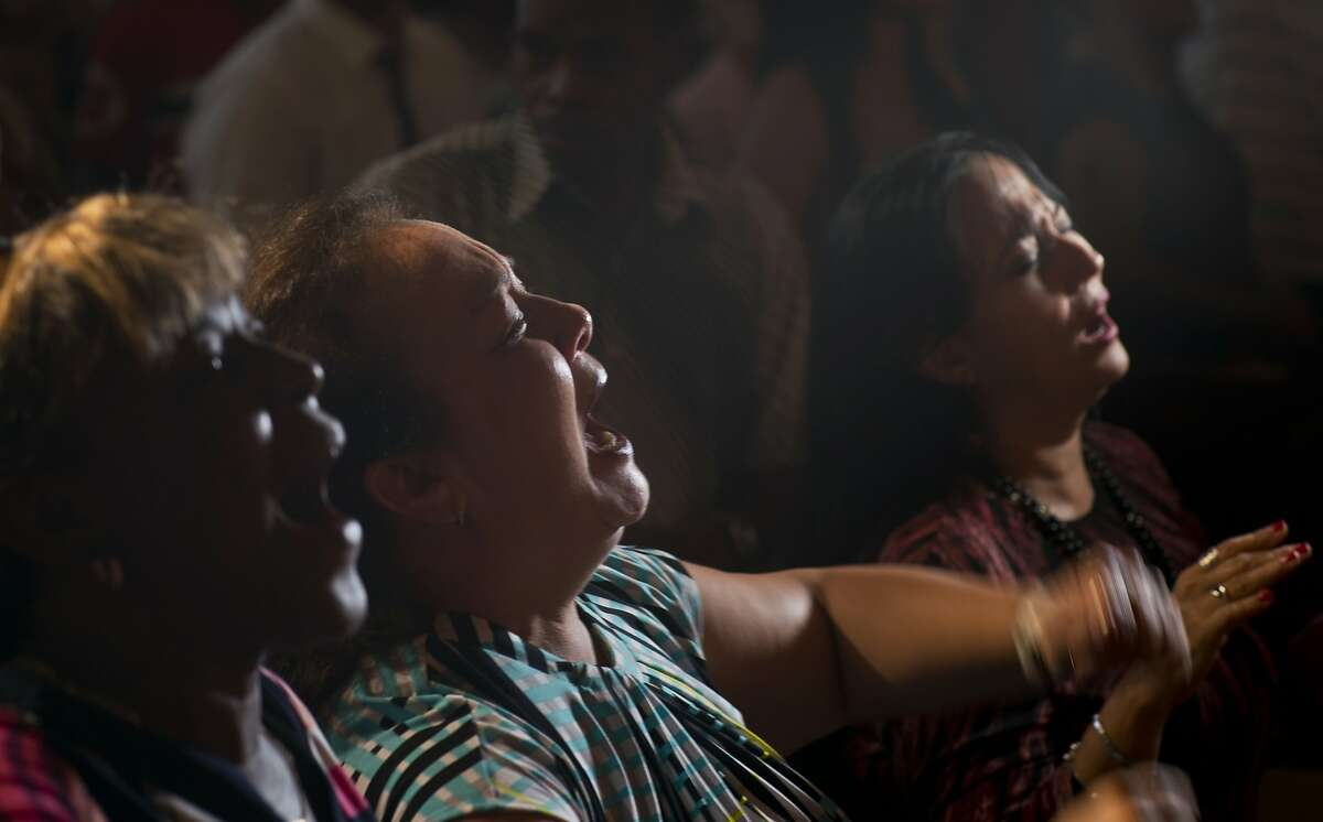 Evangelicals pray and cry during a service in memory of those who died in a plane crash in Havana, Cuba, Sunday, May 20, 2018. Officials say 110 people died when a charter passenger jet hired by Cuba's state-run airline, Cubana de Aviacion, crashed Friday in the rural outskirts of Havana. (AP Photo/Ramon Espinosa)