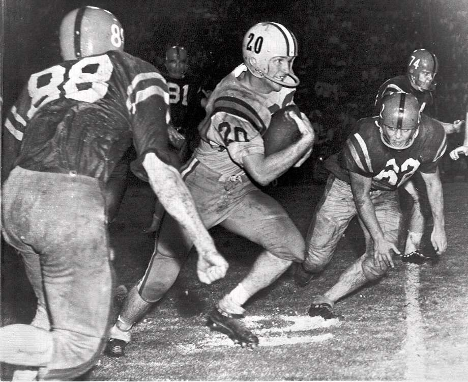 LSU's Billy Cannon begins an 89-yard punt return for a TD in 1959 that beat Ole Miss. Photo: Associated Press 1959