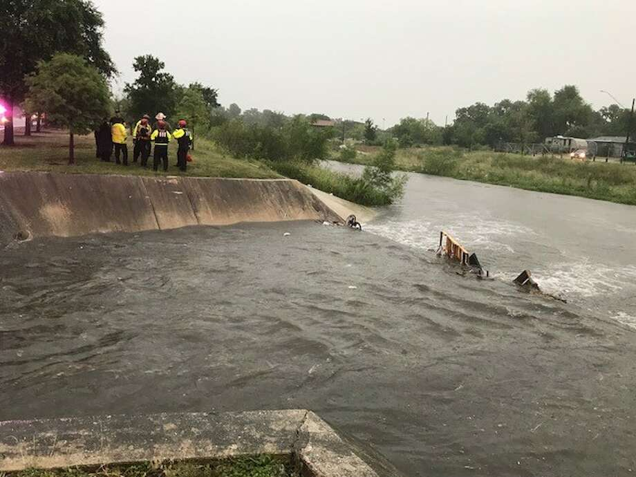 A woman is safe and in stable condition after being swept away in flood waters Sunday night, May 20, 2018. Officials rescued the woman near Woodlawn Lake after he fell into a creek about a mile away. Photo: Alex Luna