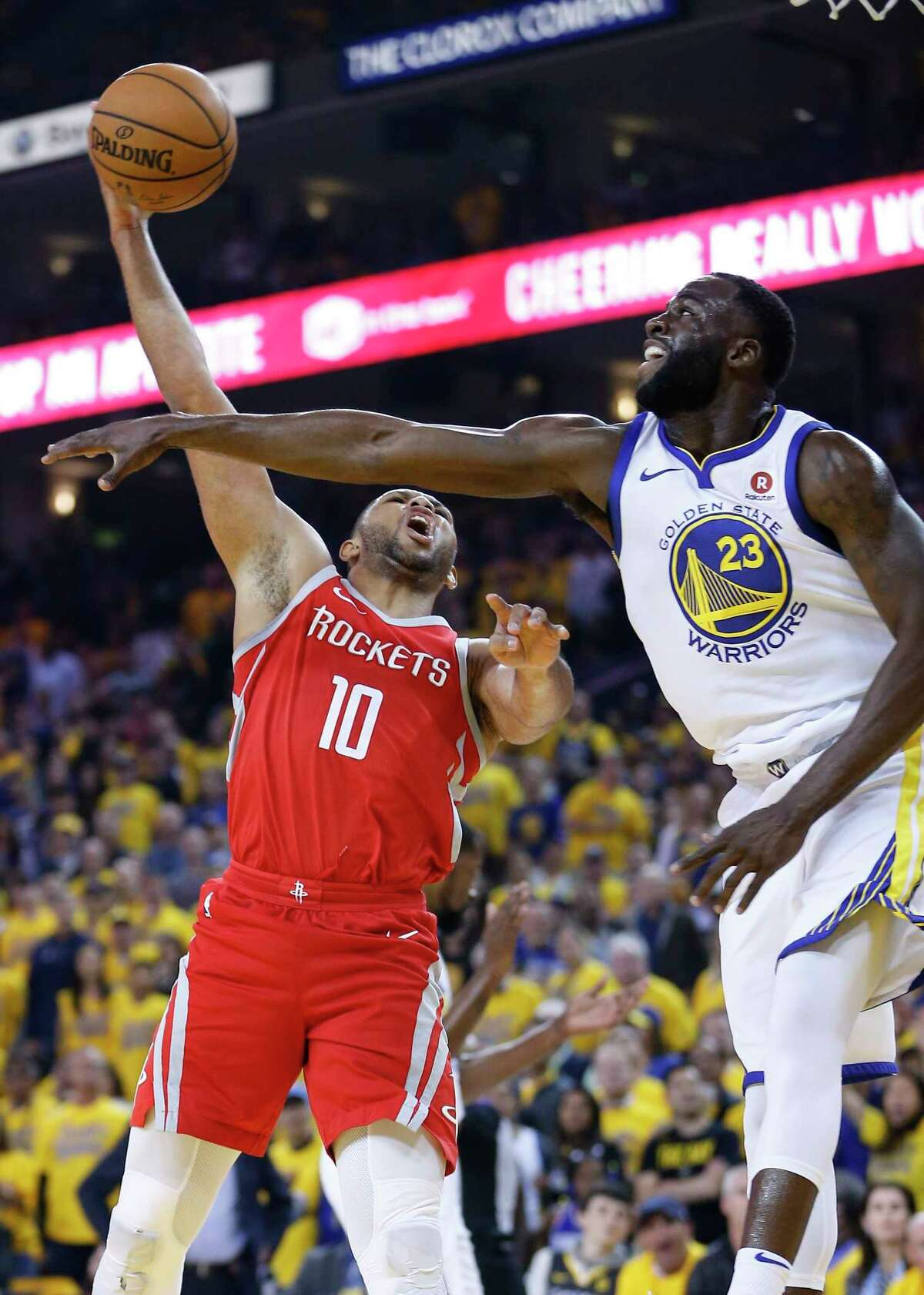 Houston Rockets guard Eric Gordon (10) takes a shot against Golden State Warriors forward Draymond Green (23) during the first half of Game 3 of the Western Conference Finals at Oracle Arena Sunday, May 20, 2018 inOakland.