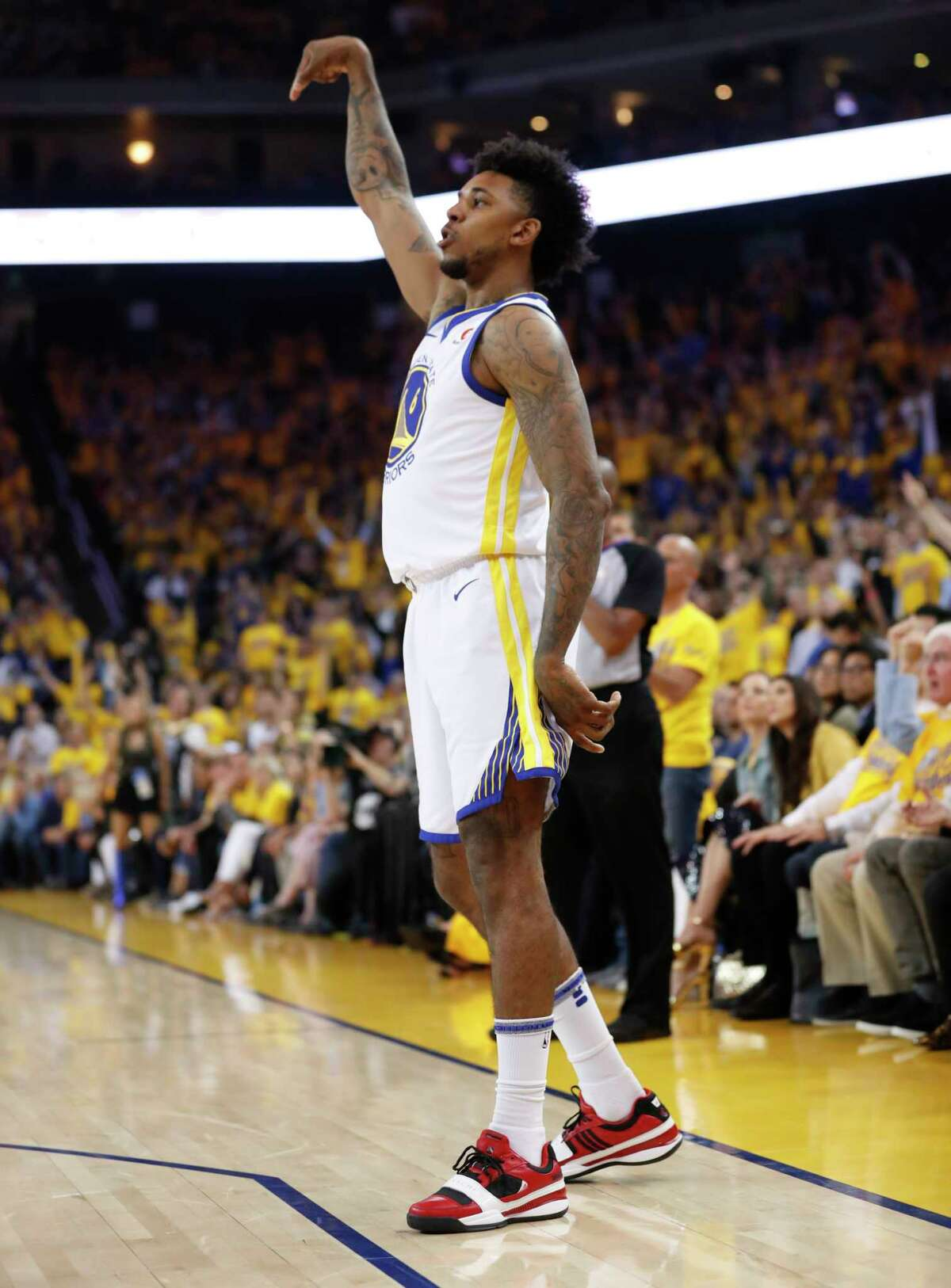 Golden State Warriors' Nick Young shoots a three-pointer in the first quarter during game 3 of the Western Conference Finals between the Golden State Warriors and the Houston Rockets at Oracle Arena on Sunday, May 20, 2018 in Oakland, Calif.