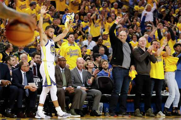 Golden State Warriors' Stephen Curry reacts in the first quarter during game 3 of the Western Conference Finals between the Golden State Warriors and the Houston Rockets at Oracle Arena on Sunday, May 20, 2018 in Oakland, Calif.