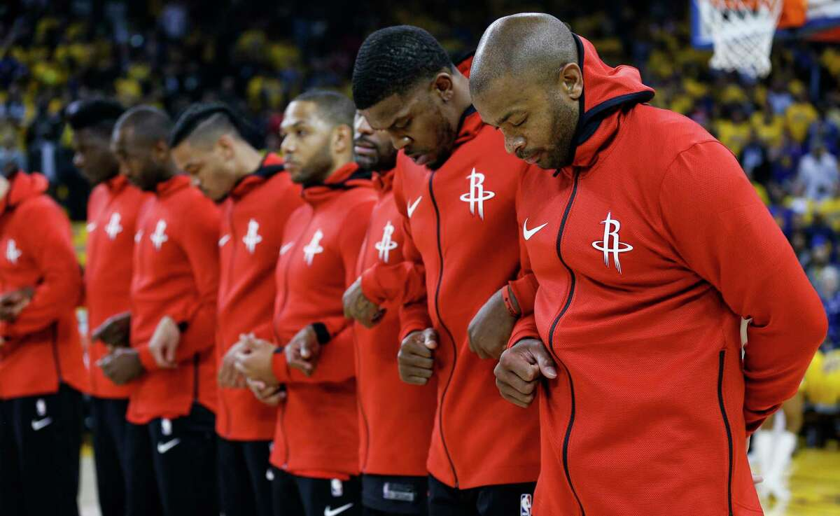 Houston Rockets players bow their heads during a moment of silence, dedicated to the victims of the Santa Fe High School shooting, before Game 3 of the Western Conference Finals at Oracle Arena Sunday, May 20, 2018 in Oakland.