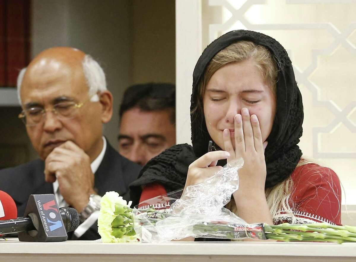 Host family daughter, Jaelyn Cogburn is overcome with emotions when talking about her exchange student / friend, Sabika Sheikh, killed in Santa Fe High School shooting at Masjid Sabireen Sunday, May 20, 2018, in Stafford. M.J. Khan is in the background. ( Steve Gonzales / Houston Chronicle )