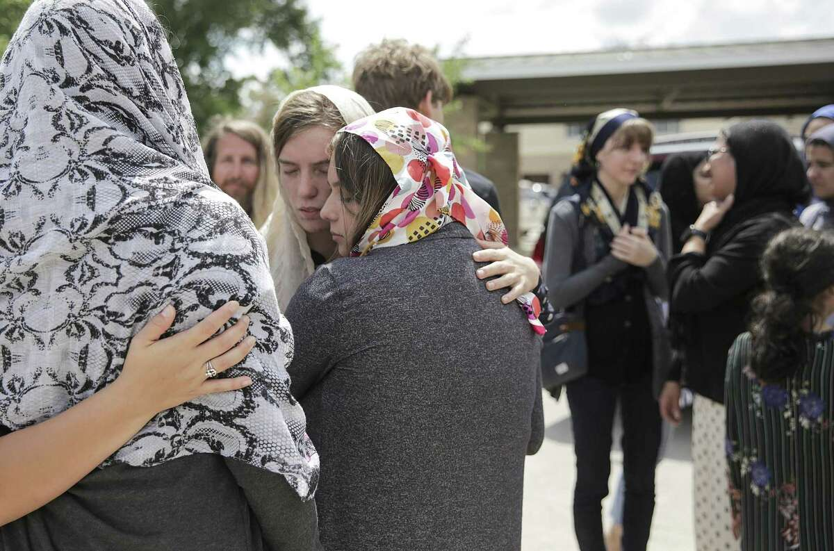 Sabika Sheikh's host family and friends comfort each other outside Masjid Al-Sabireen after funeral prayers for the exchange on Sunday, May 20, 2018 in Stafford, Texas Sheikh was killed during the school shooting at Santa Fe High School. (Elizabeth Conley/Houston Chronicle)