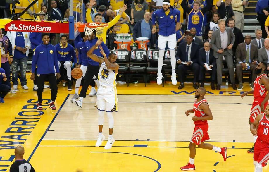 Warriors Andre Iguodala (9) with a slam in the first half, as the Golden State Warriors take on the  Houston Rockets in game 3 of the Western Conference NBA finals at Oracle Arena in Oakland, Ca., on Sun. May 20, 2018. Photo: Michael Macor, The Chronicle