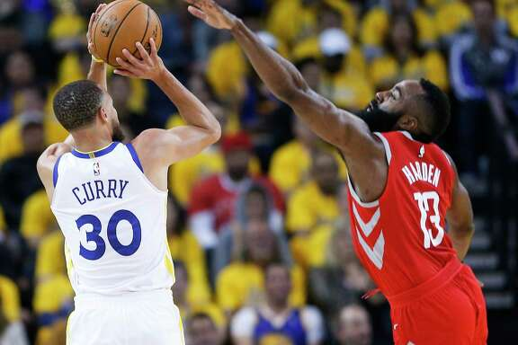 Golden State Warriors guard Stephen Curry (30) takes a shot against Houston Rockets guard James Harden (13) during the first half of Game 3 of the Western Conference Finals at Oracle Arena Sunday, May 20, 2018 in Oakalnd.