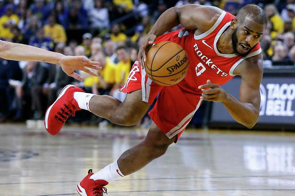Houston Rockets guard Chris Paul (3) drives to the basket against the Golden State Warriors during the first half of Game 3 of the Western Conference Finals at Oracle Arena Sunday, May 20, 2018 in Oakalnd.