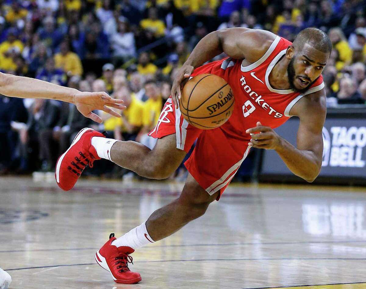 Houston Rockets guard Chris Paul (3) drives to the basket against the Golden State Warriors during the first half of Game 3 of the Western Conference Finals at Oracle Arena Sunday, May 20, 2018 in Oakland.