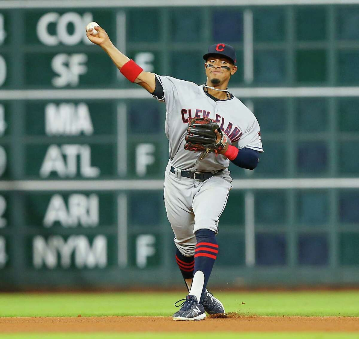 HOUSTON, TX - MAY 20: Francisco Lindor #12 of the Cleveland Indians throws to first base to retire Yuli Gurriel #10 of the Houston Astros in the fourth inning at Minute Maid Park on May 20, 2018 in Houston, Texas.