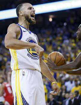 Golden State Warriors guard Stephen Curry (30) celebrates scoring on the Houston Rockets during the second half of Game 3 of the Western Conference Finals at Oracle Arena Sunday, May 20, 2018 in Oakalnd. (Michael Ciaglo / Houston Chronicle)