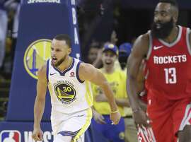 Golden State Warriors' Stephen Curry reacts in the third quarter during game 3 of the Western Conference Finals between the Golden State Warriors and the Houston Rockets at Oracle Arena on Sunday, May 20, 2018 in Oakland, Calif.