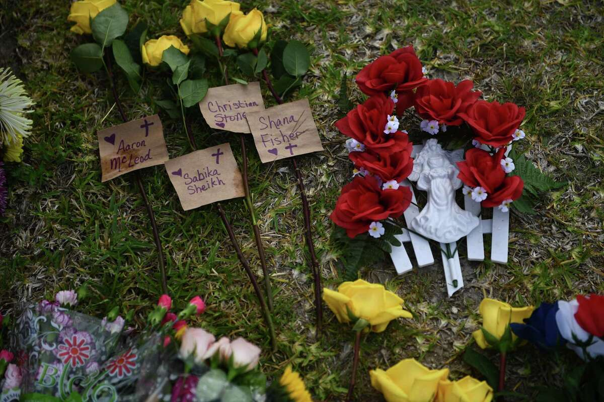 Flowers and memorials lay on the school grounds.