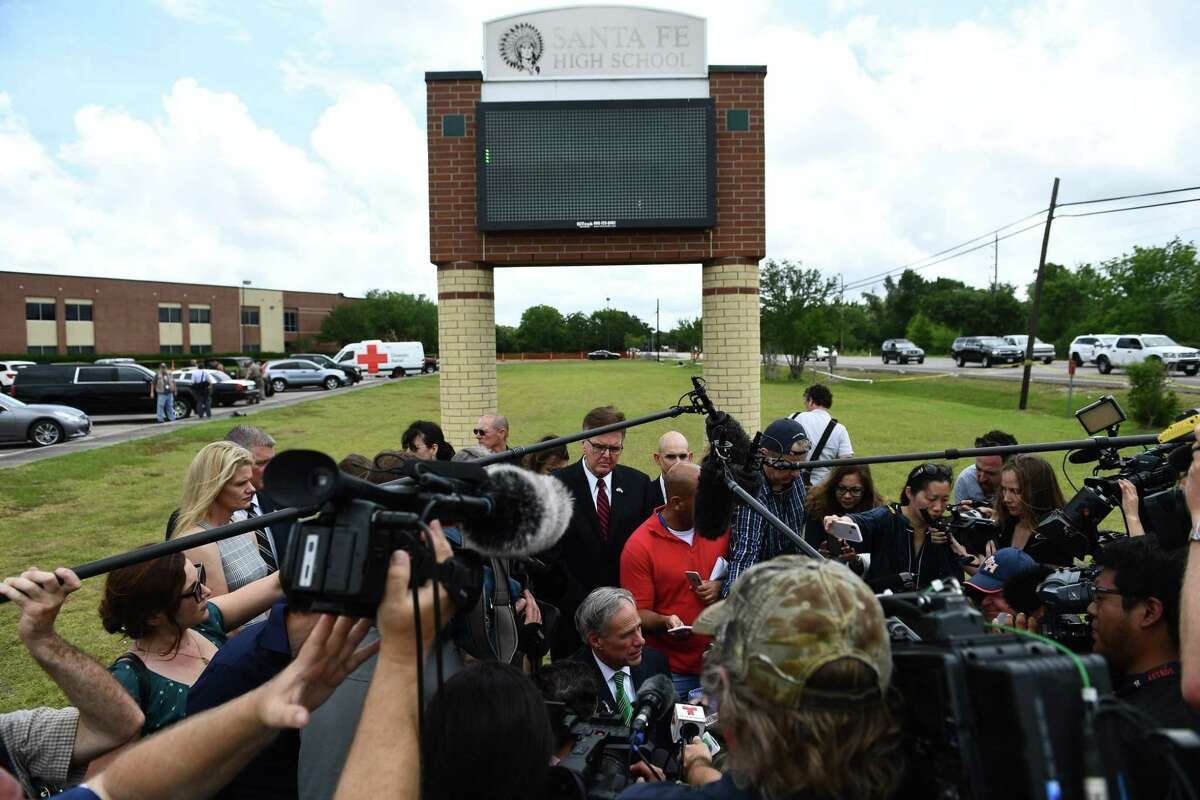 Gov. Greg Abbott speaks to the media on the grounds of Santa Fe High School. The governor also attended a service at Arcadia First Baptist Church in Santa Fe.
