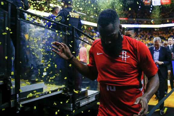 Houston Rockets guard James Harden walks off the court after losing to the Golden State Warriors 126-85 in Game 3 of the Western Conference Finals at Oracle Arena Sunday, May 20, 2018 in Oakalnd.