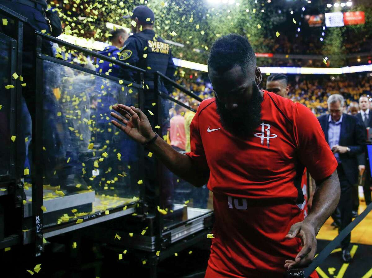 Houston Rockets guard James Harden walks off the court after losing to the Golden State Warriors 126-85 in Game 3 of the Western Conference Finals at Oracle Arena Sunday, May 20, 2018 in Oakland.