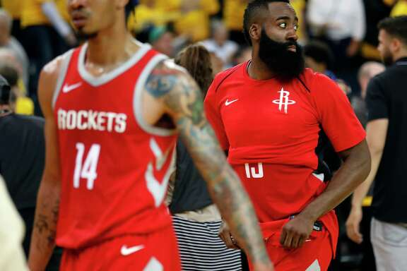 Houston Rockets' James Harden and Gerald Green (14) leave the court after Golden State Warriors' 126-85 win in NBA Western Conference Finals Game 3 at Oracle Arena in Oakland, CA on Sunday, May 20, 2018.