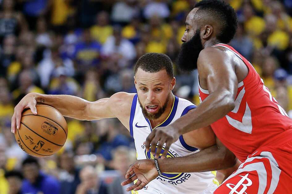 Golden State Warriors guard Stephen Curry (30) works against Houston Rockets guard James Harden (13) during the second half of Game 3 of the Western Conference Finals at Oracle Arena Sunday, May 20, 2018 in Oakalnd.
