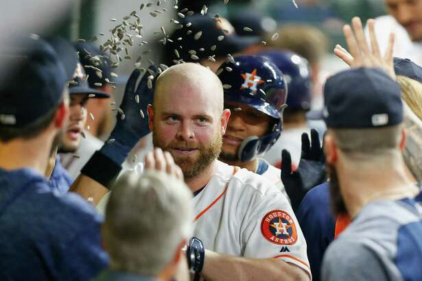 HOUSTON, TX - MAY 20:  Brian McCann #16 of the Houston Astros is congratulate in the dugout after hitting a two-run home run in the seventh inning against the Cleveland Indians at Minute Maid Park on May 20, 2018 in Houston, Texas.