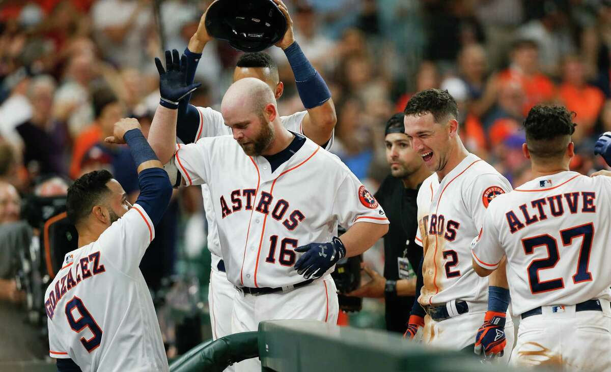 HOUSTON, TX - MAY 20: Brian McCann #16 of the Houston Astros is congratulated by Marwin Gonzalez #9, Alex Bregman #2, Carlos Correa #1 and Jose Altuve #27 after hitting a two-run home run in the seventh inning against the Cleveland Indians at Minute Maid Park on May 20, 2018 in Houston, Texas.