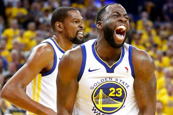 Golden State Warriors' Draymond Green and Kevin Durant react during a 3rd quarter run during 126-85 win over Houston Rockets during NBA Western Conference Finals Game 3 at Oracle Arena in Oakland, CA on Sunday, May 20, 2018.