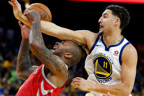Golden State Warriors' Klay Thompson defends Houston Rockets' PJ Tucker during Warriors' 126-85 win during NBA Western Conference Finals Game 3 at Oracle Arena in Oakland, CA on Sunday, May 20, 2018.