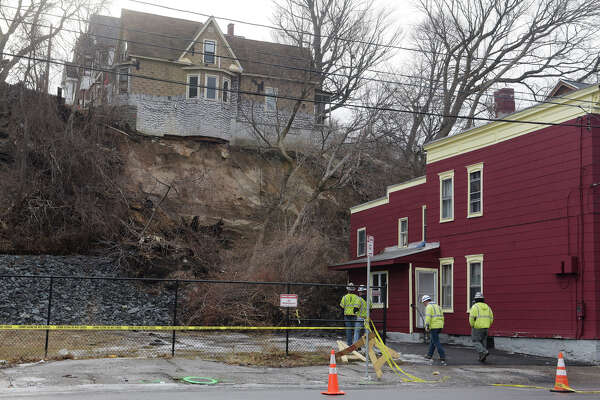 A view of a home up on Barney Street, where the hill gave way causing damage to buildings below on Nott Terrace, seen here on Sunday, Jan. 28, 2018, in Schenectady, N.Y.  (Paul Buckowski/Times Union)