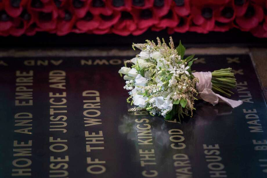 Basking in royal afterglow times union meghan markles wedding bouquet is laid on the grave of the unknown warrior in the west m4hsunfo Images