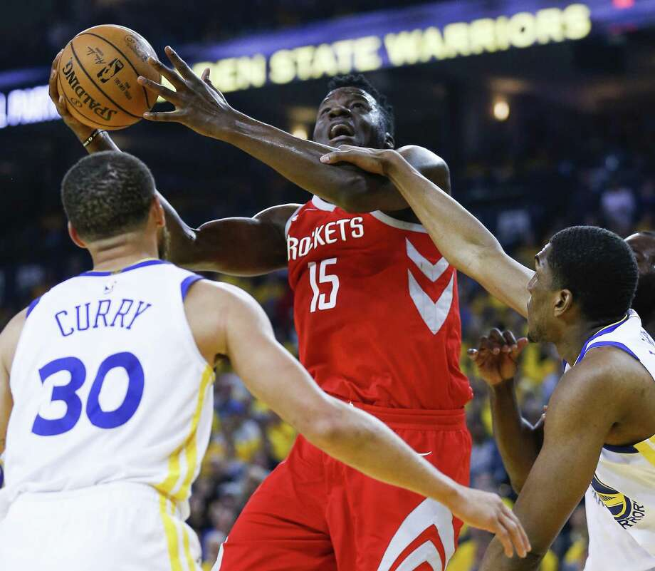 Rockets center Clint Capela (15) is fouled by Warriors forward Kevon Looney (5) during the first half of Game 3. Capela muscled his way to 13 points anyway. Photo: Michael Ciaglo, Houston Chronicle / Houston Chronicle / Michael Ciaglo