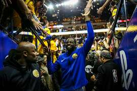 Draymond Green high-fives fans after winning Game 3 of the Western Conference Finals between the Golden State Warriors and the Houston Rockets at Oracle Arena in Oakland, California, on Sunday, May 20, 2018.