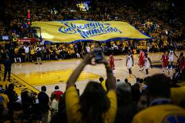 A banner is held by fans during Game 3 of the Western Conference Finals between the Golden State Warriors and the Houston Rockets at Oracle Arena in Oakland, California, on Sunday, May 20, 2018.
