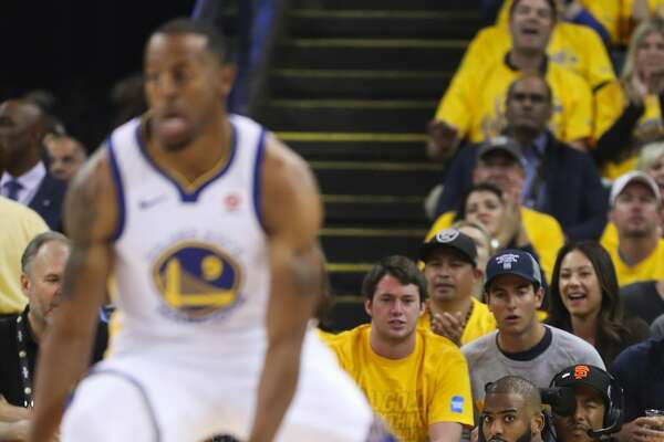 Houston Rockets Chris Paul watches the action after falling in the first quarter during game 3 of the Western Conference Finals between the Golden State Warriors and the Houston Rockets at Oracle Arena on Sunday, May 20, 2018 in Oakland, Calif.