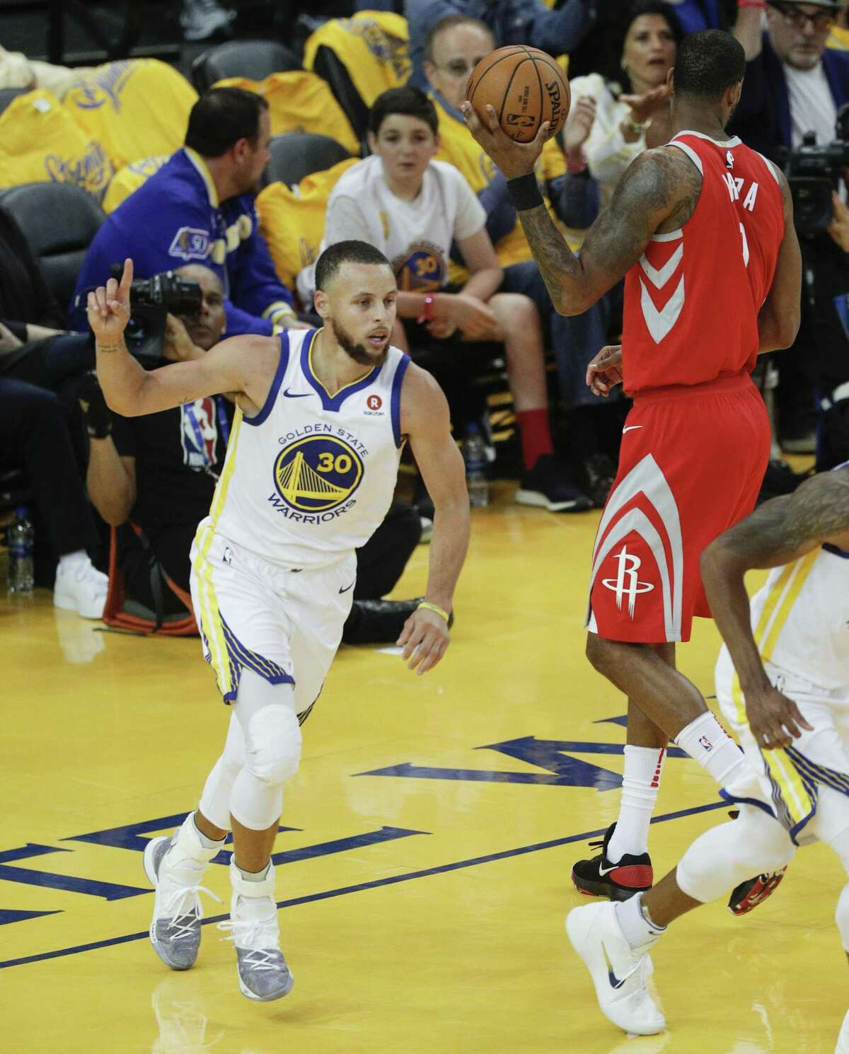 Golden State Warriors' Stephen Curry reacts in the second quarter during game 3 of the Western Conference Finals between the Golden State Warriors and the Houston Rockets at Oracle Arena on Sunday, May 20, 2018 in Oakland, Calif.