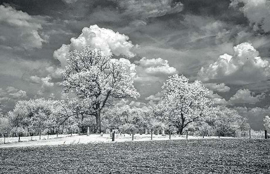 A black-and-white infrared photo casts an eerie glow on Henderson Cemetery near Arcadia.