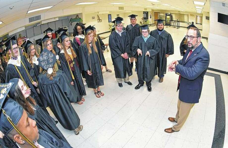 Principal Stephen Groll gives A-C Central graduates last-minute instructions before Sunday's graduation ceremony. Photo:     David Blanchette | Journal-Courier