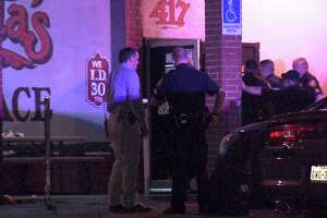 The suspects opened fire shortly after 2 a.m. at Santa's Place bar in the 400 block of Spriggsdale Boulevard.
