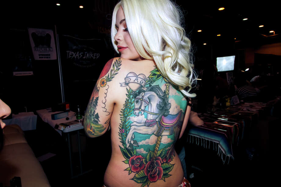 """My grandmother had an obsession for carousel horses. This back piece was tattooed in her honor."" - Monica Zamora