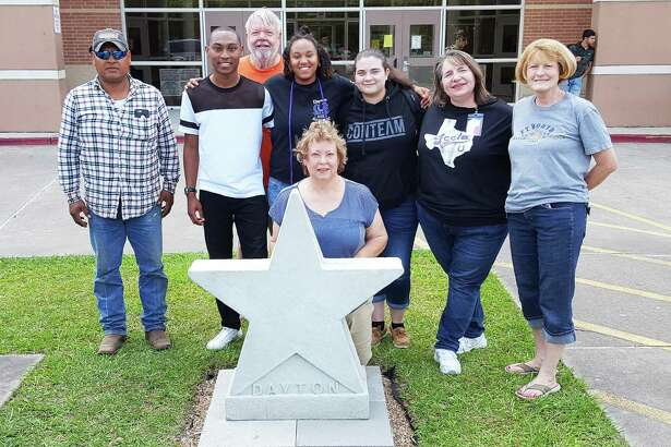 Debra Stephenson, family consumer science teacher at DHS and Senior Class sponsor, and three of her students were on hand to welcome the Dayton Historical Society to campus as they placed a Dayton star in the front of the high school. The Senior Class of 2018 raised funds and used them to purchase a star from the historical society. In the coming weeks, students will use leftover funds and additional funds from the PTO to paint the star. Pictured left to right are Refugio Garcia, De'Veon Foster, David Parker (back), Tayelin Grays, Aline Parker (kneeling), Aidee Garza, Stephenson, and Caroline Wadzeck.